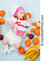 Baby girl wearing a chef hat with fruits. Use it for a...