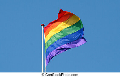 Rainbow flag gay symbol with a blue background