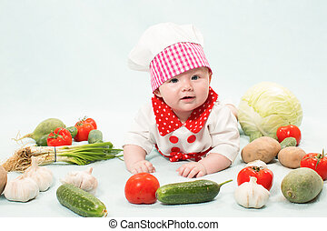 Baby girl wearing a chef hat with vegetables. Use it for a...