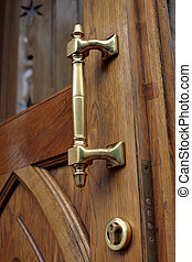 Old-fashioned door-handle - Old-fashioned frazzle brass door...