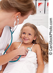 Healthcare professional checking up on little girl