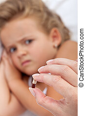 Child grimacing when receiving medication