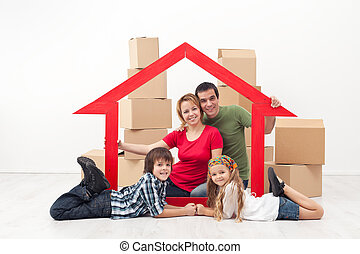 Family in a new home concept - Happy family in a new home...