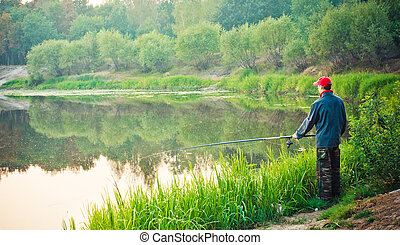 Fisherman Casting on Calm River - Fisherman catches of...