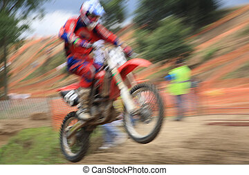 Motocross rider in motio - Motorcross rider, abstract image...