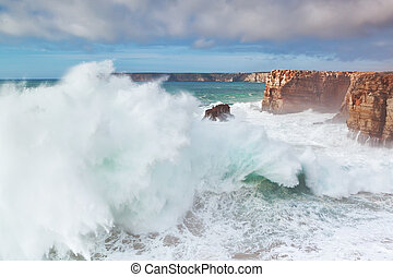 Giant sea wave going ashore in a storm.
