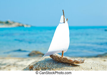 Ship toy model on the beach - Small wooden ship toy model in...