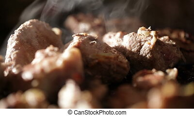 Meat on the BBQ. - Nice pieces of meat are fried on the...