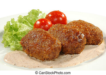 meat dish - cutlets, sauce, tomatos and salad