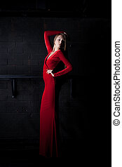 Young woman in red long dress - night club