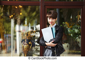Young businesswoman with a folders