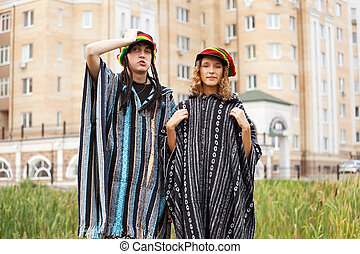 Young rastafarian couple on a city street