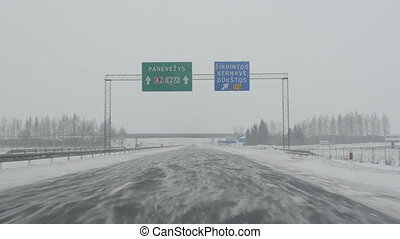 highway drive snow winter - driving on highway. snow falling...