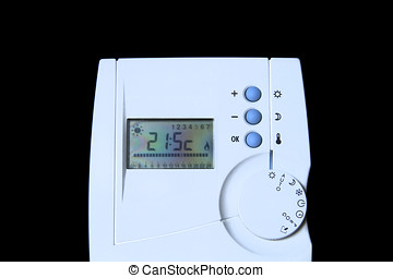 Digital thermostat over a black background