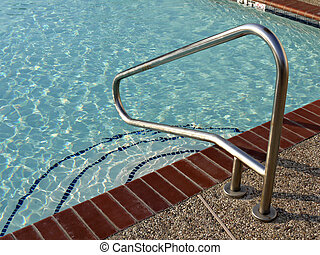 Metal handrail at a swiming pool - A image of a metal hand...