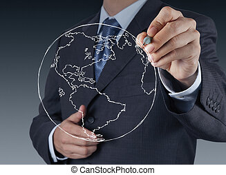 businessman hand drawing abstract globe on virtual screen