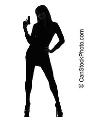 sexy detective woman holding aiming gun silhouette - one...