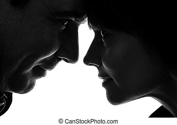 couple woman man face to face silhouette - one caucasian...