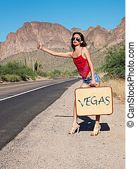 Vegas Baby - Beautiful young lady with case hitching a ride...