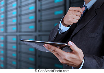 businessman hand using tablet computer and server room...