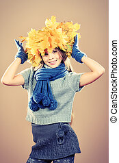 offspring - Portrait of a smiling girl in autumn clothes and...