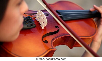 playing the violin - girl playing the violin in extremely...
