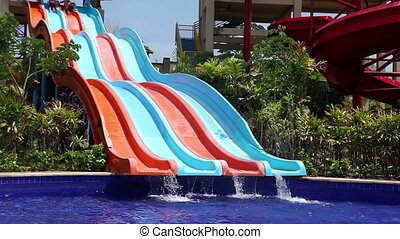 happiness in water park - boy and girl on water slides