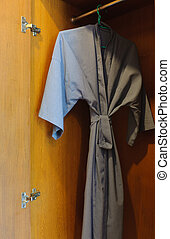 Bathrobes  hanging in a closet
