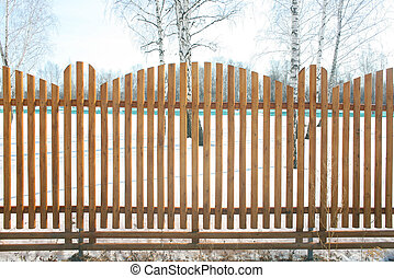 winter field behind wooden fence - winter field protected...