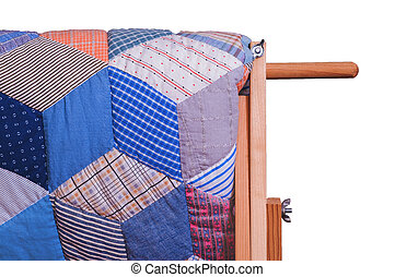 Detail View Of Antique Quilt On Wooden Stand, White Isolation