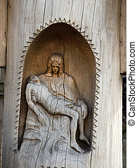 Pieta in a small chapel carved in a tree trunk