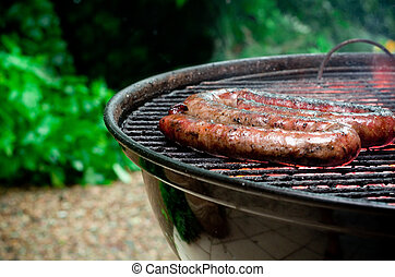 Tradtional South African braai barbecue borewors sausage on...
