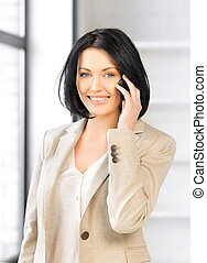 businesswoman with cell phone - bright picture of...
