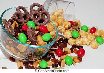 Snack food - A glass bowl filled with various nuts and...