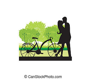 sillhouette of sweet young couple in love standing in the...