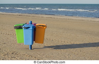 Garbage cans on the beach in Cervia in Italy