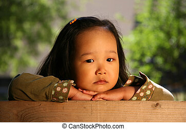 Korean child - The three-year sad Korean girl covered by the...