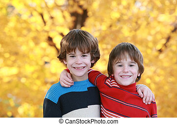 Boys in the Fall - Two Brothers Hugging in the Fall