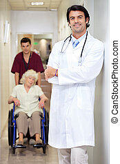 Doctor With Patient And Male Technician - Portrait of doctor...
