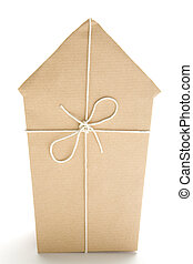 House Wrapped In Brown Paper - Studio Shot Of House Wrapped...