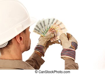 Construction worker counting money _ from behind
