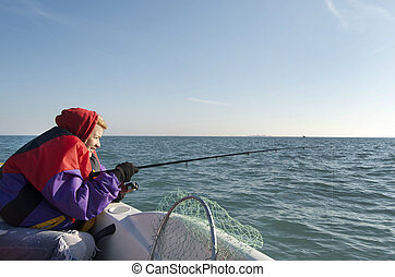 Woman Fishing The Great Lakes - Woman fishing for perch off...