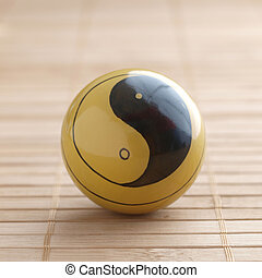 One baoding ball with the yin yang symbol in square format
