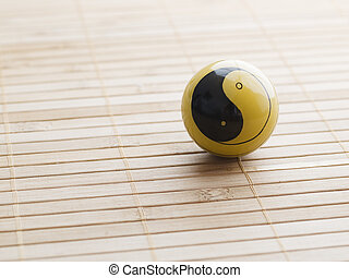 One baoding ball with the yin yang symbol