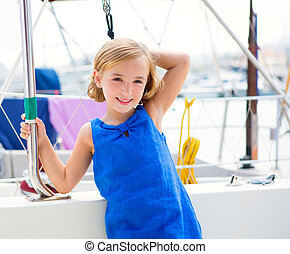 child kid girl in marina boat on summer vacations in...