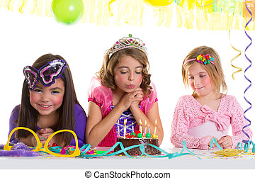 children happy girls blowing birthday party cake - children...
