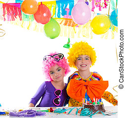 Children happy birthday party with clown wigs and chocolate...