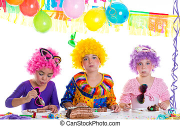 Children happy birthday party eating chocolate cake with...