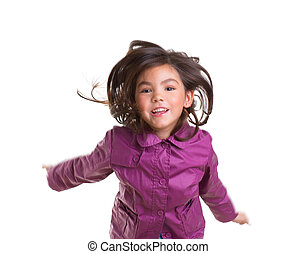 Asian child girl jumping happy with winter purple coat...
