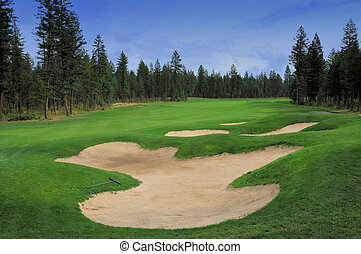 sand hazard - sand trap on golf course